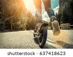 woman on her  kick scooter on... | Shutterstock . vector #637418623