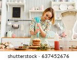 beautiful girl cooks in the... | Shutterstock . vector #637452676