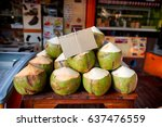 fresh coconuts for sale on... | Shutterstock . vector #637476559