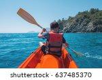 boy in life jacket on orange... | Shutterstock . vector #637485370