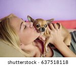teenage girl with her dog... | Shutterstock . vector #637518118