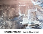glass of water on a wooden... | Shutterstock . vector #637567813