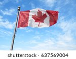 canadian flag waving in the wind | Shutterstock . vector #637569004