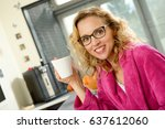 young blonde woman drinks a... | Shutterstock . vector #637612060