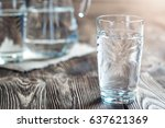 glass of water on a wooden...   Shutterstock . vector #637621369