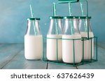 a bottles of milk on a wooden... | Shutterstock . vector #637626439