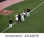 Small photo of SAN FRANCISCO, CA - OCTOBER 20: Giants vs. Phillies: Giants Players stand with hats removed during National anthem before the start of game four NLCS 2010 October 20, 2010 AT&T Park San Francisco.