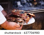 Grilling Steaks Serving In...