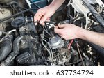 the master repairs under the... | Shutterstock . vector #637734724