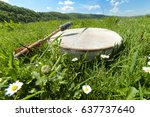 shamanic tambourine on a meadow   Shutterstock . vector #637737640