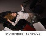 srangled college girl lying on...   Shutterstock . vector #63784729