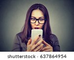 shocked woman looking at mobile ... | Shutterstock . vector #637864954