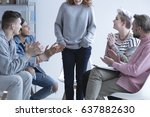 Small photo of Girl overcoming depression, talking in front of support group