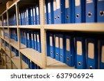 blue files arranged on shelves... | Shutterstock . vector #637906924