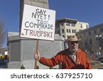 "Small photo of Asheville, North Carolina, USA - February 25, 2017: A man holds a sign that says ""Say Nyet to Comrade Trumpski"" alluding to Trump's alleged treasonous relationship with Russia and urging resistance"