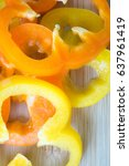 orange pepper nuzzled with... | Shutterstock . vector #637961419