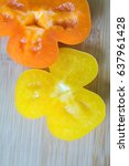 orange pepper nuzzled with... | Shutterstock . vector #637961428