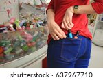 woman trying to steal items in... | Shutterstock . vector #637967710