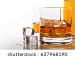 whiskey glass with ice on white ... | Shutterstock . vector #637968190
