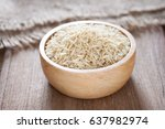 brown rice in a bowl on wooden... | Shutterstock . vector #637982974