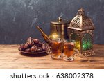 lightened lantern  tea cups and ... | Shutterstock . vector #638002378