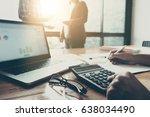 business team using a... | Shutterstock . vector #638034490