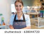 woman working in coffee shop  | Shutterstock . vector #638044720
