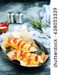 chicken with cheese | Shutterstock . vector #638053339