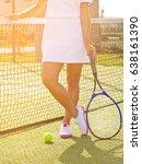 happy girl stands with racket... | Shutterstock . vector #638161390