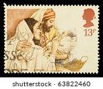 Small photo of UNITED KINGDOM - CIRCA 1984: A British Used Christmas Postage Stamp showing Mary, Joseph and Jesus, circa 1984