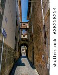 Small photo of Overview of a narrow alleyway with old buildings and traffic sign at the town of Orvieto, a pleasant and well preserved medieval city. Located in Umbria, central Italy