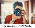 young man photographer making... | Shutterstock . vector #638274094
