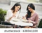 pretty young women having lunch ... | Shutterstock . vector #638361100