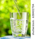 glass of water on nature... | Shutterstock . vector #638402704
