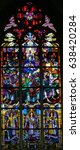Small photo of ANTWERP, BELGIUM - APRIL 30, 2017: Stained Glass window in the Church of Saint Andrew in Antwerp, Belgium, depicting Mary and the Apostles at Pentecost