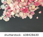 Stock photo pink petals and roses wallpaper roses and petals on rustic black chalk background 638428630