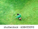 man worker cutting  grass with... | Shutterstock . vector #638455093