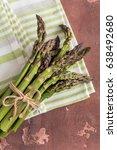 fresh asparagus on concrete... | Shutterstock . vector #638492680