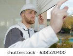 contractor looking at window... | Shutterstock . vector #638520400