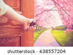 women hand open door knob or... | Shutterstock . vector #638557204