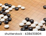 Small photo of Chinese go game board, close up view of playing black and white stone pieces, Alphago