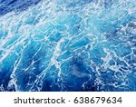White Spume On Blue Water Of...