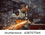 Worker Sawing Metal With A Saw...