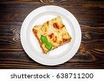portion of tasty lasagna on... | Shutterstock . vector #638711200