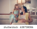 pregnant woman with her... | Shutterstock . vector #638738086