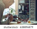man repairman is trying to fix... | Shutterstock . vector #638896879