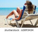 Sexy Woman Is Lying On Beach...