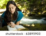 Young Woman Reading Bible By...