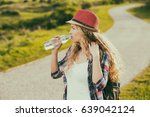 Beautiful Young Woman Drinking...