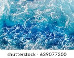 Blue Frothy Surface Of Sea...